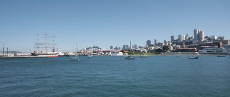A panorama of the beautiful and hilly San Francisco skyline seen from the bay's waters. photo