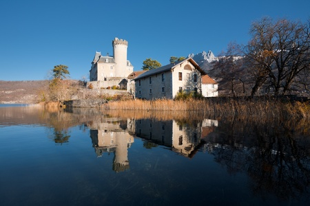A Medieval Fairytale Castle At The Foot Of The French Alps Reflected In Lake Annecy With