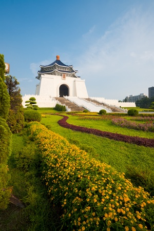 Colorful flowers and grass at the base of the Chiang Kai Shek Memorial Hall in Taipei.  Vertical
