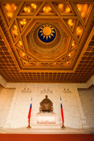 A beautifully ornate ceiling and a statue of Chiang Kai Shek inside the cavernous Memorial Hall in Taipei, Taiwan
