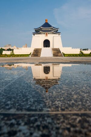 The Chiang Kai Shek Memorial Hall reflected in a puddle of rainwater