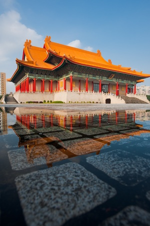 Taipei National Concert Hall beautifully reflected in a puddle of rainwater Reklamní fotografie - 12533350