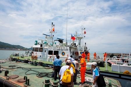 guard ship: Matzu Island, Taiwan - August 15, 2011: Taiwanese cost guard members welcome aboard a group of Taiwanese dignitaries onto a cutter boat August 15 at Matzu Island, Taiwan