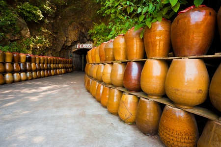 The entrance to an old military tunnel, Tunnel 88 now acts as a storage area for large jars which contain locally distilled alcohol and spirits.  It is now a major tourist attraction on Nangan Island of the Matsu archipelago in Taiwan.