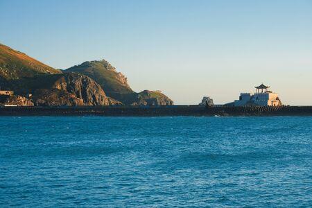 At dawn, the Ganen Pavilion rests on a causeway between Xiyin and Dongyin islands on the Matsu archipelago in Taiwan Reklamní fotografie - 12541488