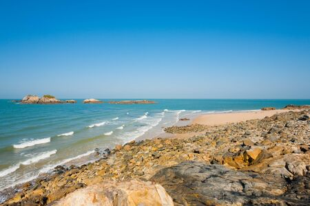 A rocky pristine beach lies beautifully untouched on Juguang Island of the Matsu Islands in Taiwan.  Horizontal Reklamní fotografie