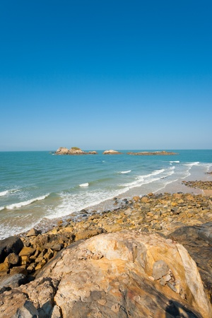 A rocky pristine beach lies beautifully untouched on Juguang Island of the Matsu Islands in Taiwan.  Vertical