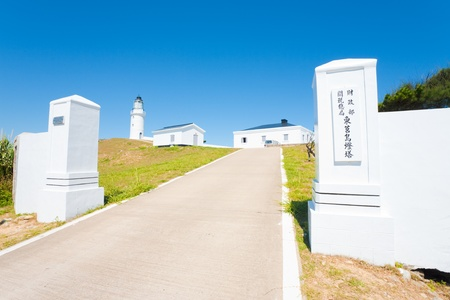 The gated entrance to the white Dongju lighthouse standing high on a hill in Juguang Island of the Matsu Islands in Taiwan