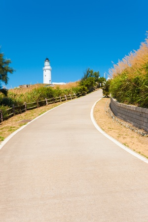 A long fenced driveway leads to the Dongju Lighthouse on Juguang island on the Matsu Islands in Taiwan Reklamní fotografie
