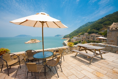 A beautiful view of Turtle island can be seen while relaxing at a rest area viewpoint in the stone village of Qinbi on Beigan island of the Matsu Islands in Taiwan