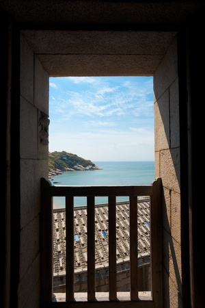 A beautiful sea view from a local landmark, the Pirate House, a must-see in Qinbi village on Beigan Island on the Matsu archipelago in Taiwan photo
