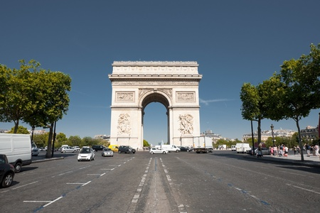 champs: A view down Champs Elysees avenue at the centered iconic Arc De Triomphe in Paris, France.  Horizontal. Stock Photo
