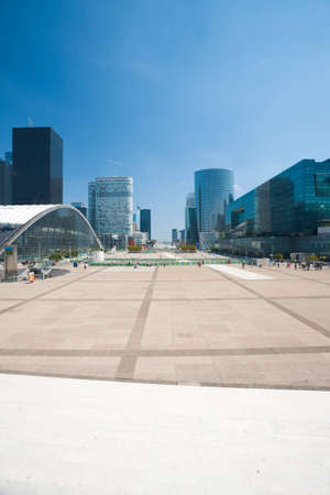A view down the concourse of La Defense and its office buildings from the steps of the Grande Arche in Paris, France.  Vertical Stock Photo - 12533355