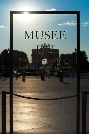 A beautifully backlighted glass sign at the entrance courtyard to the Louvre museum in Paris, France. Stock Photo - 12533356