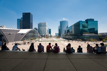 Paris, France - July 5, 2011: A sweeping view of the La Defense area of Paris from the top steps of the Grande Arche, a popular spot to relax and grab lunch July 5, 2011 at Paris, France