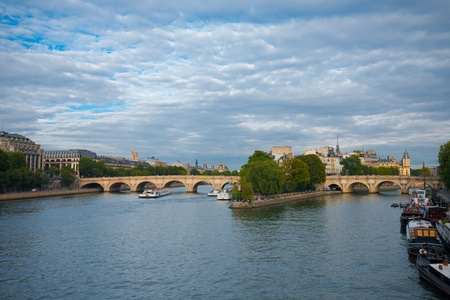 A beautiful cityscape including Pont Neuf bridge connecting to Ile de la Cite over the Seine river in the heart of Paris, France. Stock Photo - 13225462