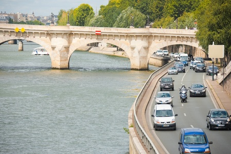 Paris, France - July 6, 2011: Traffic on the low riverside road next to the Seine River.  Paris suffers from some of the worst traffic jams in Europe.  Horizontal Composition July 6, 2011 at Paris, France