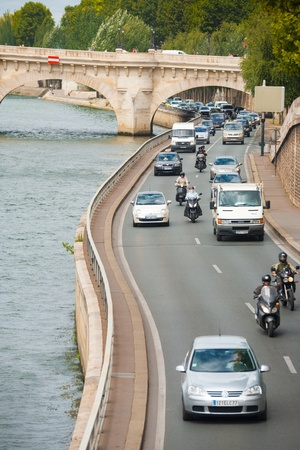 Paris, France - July 6, 2011: Traffic on the low riverside road next to the Seine River.  Paris suffers from some of the worst traffic jams in Europe.  Vertical Composition July 6, 2011 at Paris, France