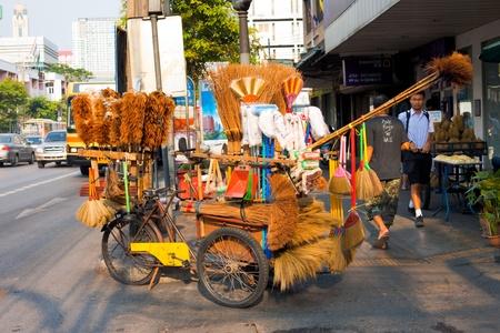 selfemployed: Bangkok - June 1, 2011: A door to door cleaning supplies bike cart is part of an informal economy of self-employed people June 1, 2011 at Bangkok