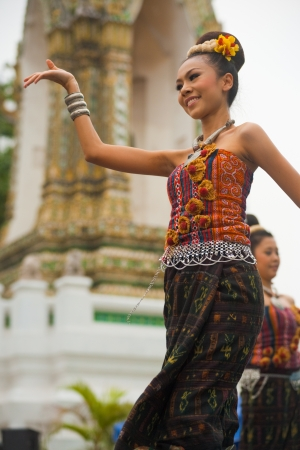 Bangkok, Thailand - April 9, 2011: A beautiful traditional northern Thai dancer performs at Wat Pho during Songkran, Thai new year, a major festival on the Thai calendar April 9, 2011 at Bangkok, Thailand