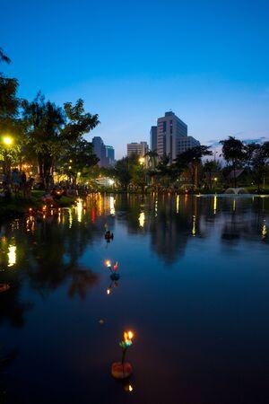 Krathong boats float on the lake at Lumpini Park during the festival of Loi Krathong in Bangkok, Thailand photo