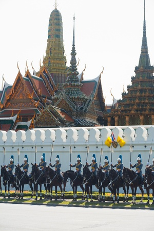 regalia: BANGKOK - DECEMBER 5, 2010: Members of the Royal Mounted Guard await the arrival of the King in front of the Grand Palace for the Kings birthday parade on December 5, 2010 in Bangkok