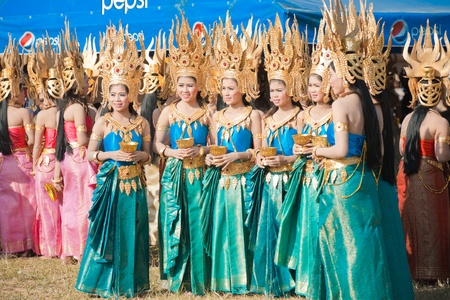 SURIN, ISAN, THAILAND - NOVEMBER 20, 2010: Beautifully dressed Thai dancers wait to enter the stage at the annual Surin Elephant Roundup on November 20, 2010 in Surin, Thailand Stock Photo - 13574455