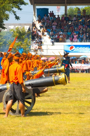 SURIN, THAILAND - NOVEMBER 20, 2010: Archers and cannons fire during a Burmese Siamese War reenactment at the Surin Elephant Roundup on November 20, 2010 in Surin, Thailand
