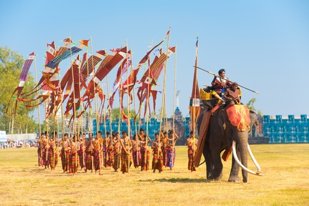 surin: SURIN, THAILAND - NOVEMBER 20, 2010: A Burmese general marches in with his soldiers during the Burmese Siamese War reenactment at the Surin Elephant Roundup on November 20, 2010 in Surin, Thailand