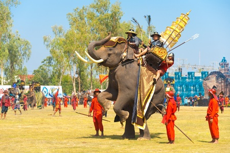 SURIN, THAILAND - NOVEMBER 20, 2010: King Naresuans elephant rears up on its hind legs during a Burmese Siamese War reenactment at the Surin Elephant Roundup on November 20, 2010 in Surin, Thailand