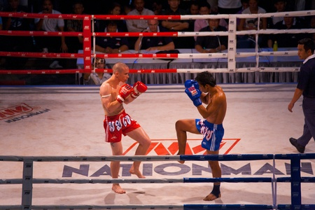 BANGKOK, THAILAND - NOVEMBER 17, 2010: Muay Thai kickboxers square off in a traditional form of feeling out the competition at Fight Night at MBK on November 17, 2010 in Bangkok, Thailand