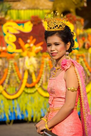 SURIN, ISAN, THAILAND - NOVEMBER 19, 2010: A beauty queen in a pink traditional dress marches in the parade in downtown at the annual Surin Elephant Roundup on November 19, 2010 in Surin, Thailand
