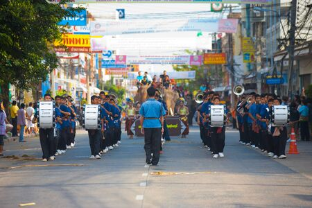 surin: SURIN, ISAN, THAILAND - NOVEMBER 19, 2010: A marching band of young teenagers walks down a street in a parade at the annual Surin Elephant Roundup on November 19, 2010 in Surin, Thailand