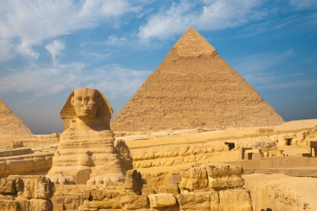 A beautifully clear blue sky behind the Sphinx and Khafre Pyramid side by side in Giza, Cairo, Egypt