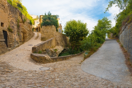 provencal: A set of narrow streets at sharp hairpin turn angles in the picturesque medievel village of Gordes, Provence, France Stock Photo