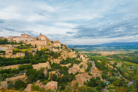 valley below: A beautiful valley below at Gordes, a picturesque medievel hilltop stone village in Provence, France.  Horizontal