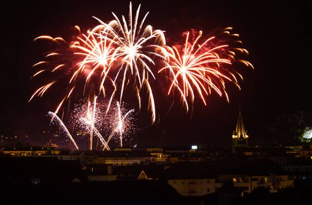 Bright fireworks light up the night sky for Bastille day, a major holiday in Annecy, France photo