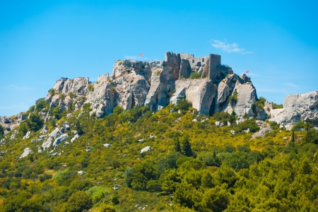 atop: Ruins of the town of Les Baux de Provence sit atop a rocky outcrop in beautiful Provence, France.  Horizontal