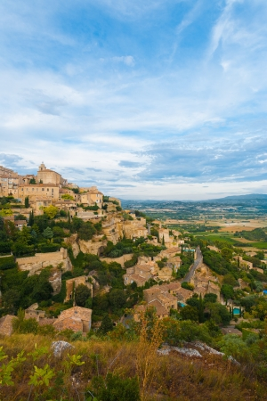 A beautiful evening at Gordes, a picturesque medieval hilltop stone village in Provence, France.  Vertical photo