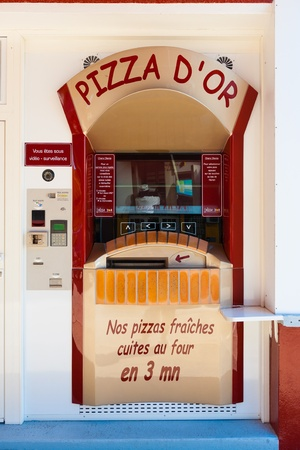 vending: EVIAN, FRANCE - SEPTEMBER 10, 2010:  A unique automated pizza vending machine is capable of cooking fresh hot pizzas in 3 minutes on September 10, 2010 in Evian, France