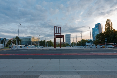 broken chair: GENEVA, SWITZERLAND - SEPTEMBER 29, 2010: The square at UN headquarters with the World IP Office and Broken Chair in Geneva, Switzerland on September 29, 2010. The UN deals with world issues daily