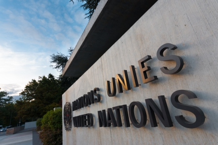 GENEVA, SWITZERLAND - SEPTEMBER 29, 2010: The United Nations sign in French and English at the UN gate in Geneva, Switzerland on September 29, 2010. The UN deals with world issues daily