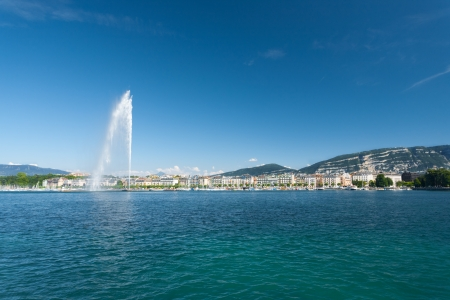 A beautiful view of the Saleve mountain and Jet Deau water fountain seen from Lake Geneva in Switzerland