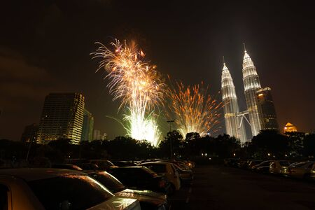 New years eve fireworks light up the night sky near the Petronas Towers Menara in Kuala Lumpur, Malaysia.  Horizontal