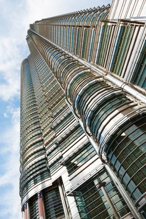 menora: A beautiful angle, looking up the side of the Petronas Towers Menora Kuala Lumpur in Malaysia Editorial