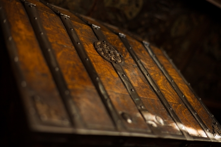 craftsmanship: The selectively focused top of a rich dark wooden trunk made with old world craftsmanship
