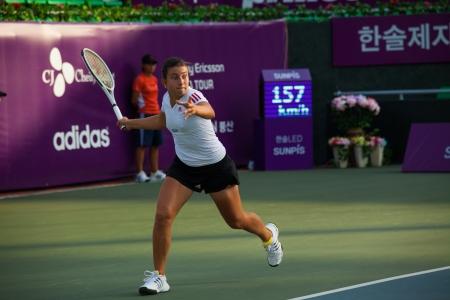 SEOUL, KOREA - SEPTEMBER 23, 2009: Latvian professional womens tennis player, Anastasija Sevastova runs down a forehand at the Hansol Korea Open on September 23, 2009 in Seoul, Korea