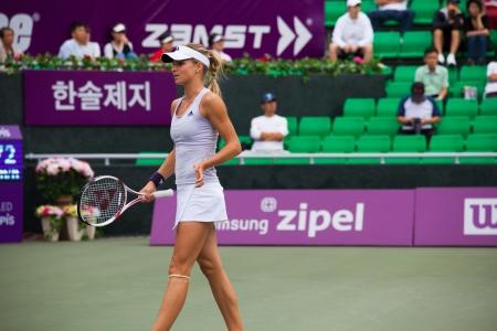 lull: SEOUL, KOREA - SEPTEMBER 23, 2009: Russian professional womens tennis player, Maria Kirilenko walks away from the play during a lull at the Hansol Korea Open on September 23, 2009 in Seoul, Korea
