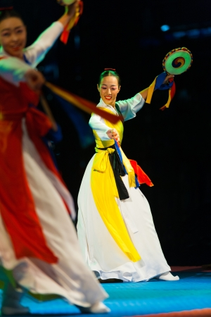 SEOUL, KOREA - SEPTEMBER 17, 2009: A pair of pretty unidentified Korean women dance and play traditional sogo drums at a free open-air summer show near city hall on September 17, 2009 in Seoul, Korea