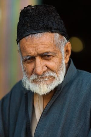 SRINAGAR, INDIA - JULY 22, 2009: An unidentified Kashmiri muslim man exits the Shah-E-Hamdan mosque, a major tourist attraction in Kashmir, on July 22, 2009 in Srinagar, India.